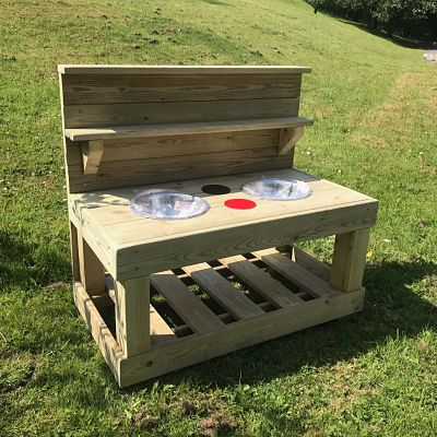 small wooden mud kitchen from discovering days with two mixing bowls and two hobs