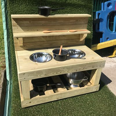 small wooden mud kitchen from discovering days