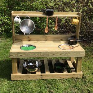 unpainted wooden mud kitchen