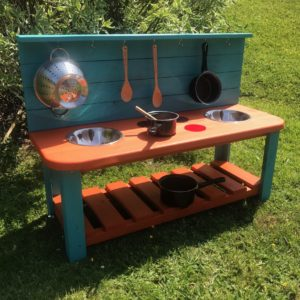 large painted wooden mud kitchen
