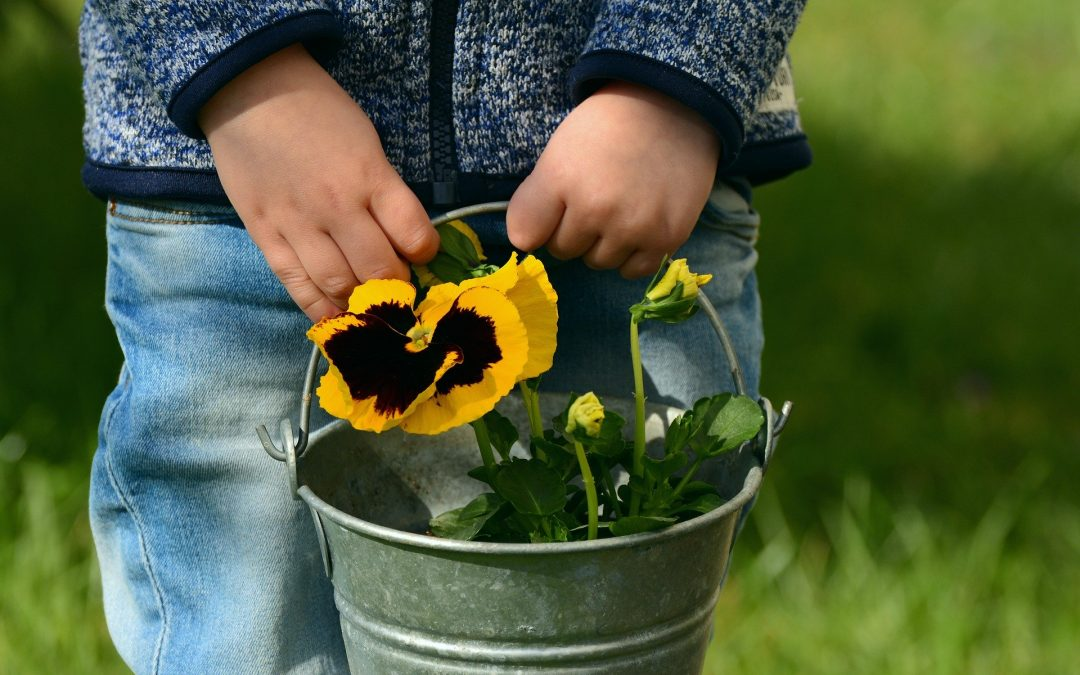 image of child with flowers for gardenign blog by Discovering Days